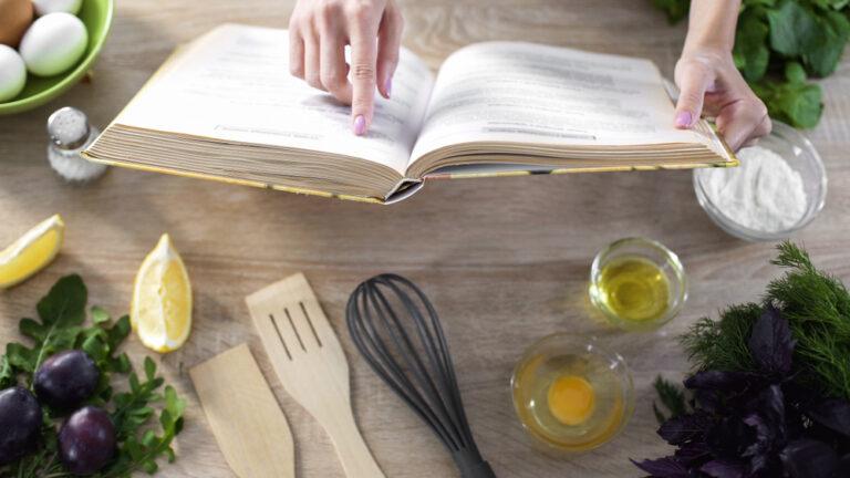 Woman reading a recipe book