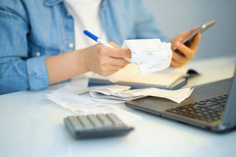 Women calculates her monthly bills