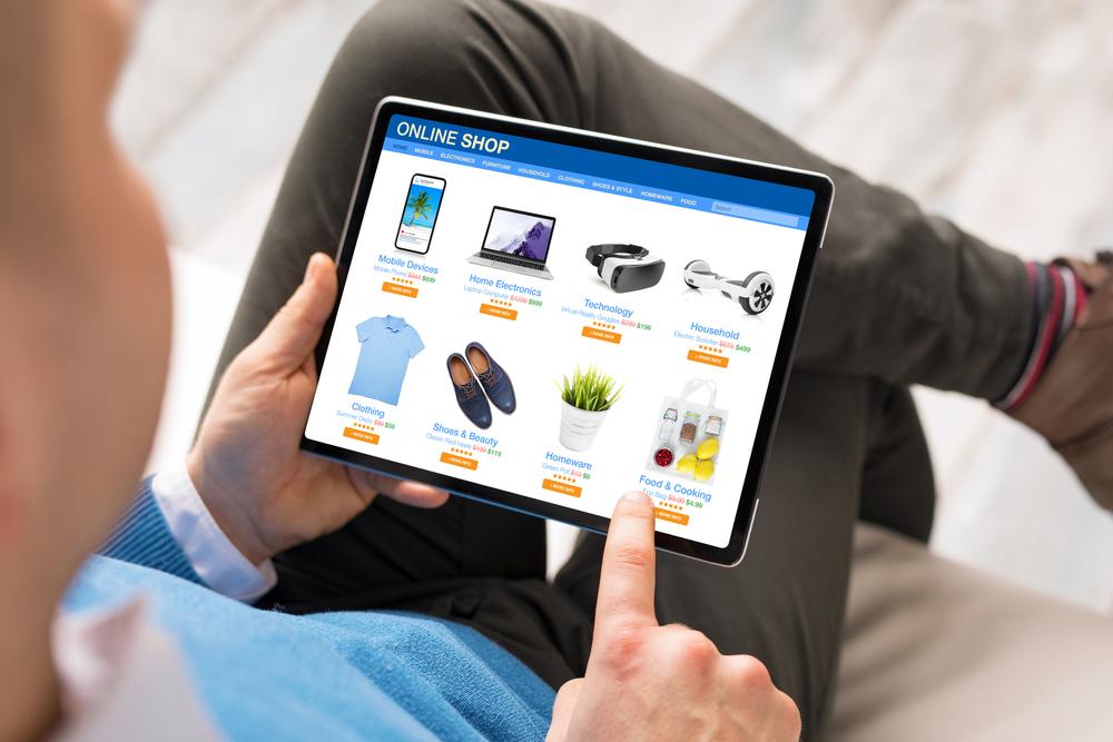 Man searching cheaper alternatives on Amazon